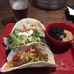 BBQ pork, super greek ( gyro ) and buffalo shrimp tacos with black beans and rice