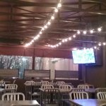 Deemers Patio has plenty of tables, heaters, cafe lights, and a tv.