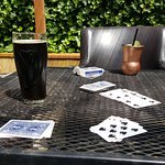 Cards and drinks in the garden.