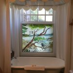 The bathroom with painted glass window