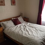 Comfortable bed with alarm clock, TV, internet, shower, etc. Lovely comfortable bed. Room 3