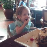 My granddaughter eating one slice of Chocolate Cake w/ Ice cream. It was as big as her head....