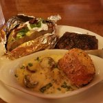 Garlic button sirloin with loaded baked potato and Parmesan crusted roll
