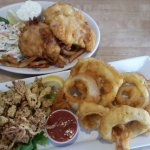 Fish and chips, coleslaw, fried calamari, onion rings