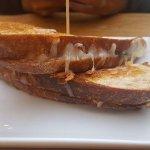 Grilled mozzarella cheddar basil sandwich