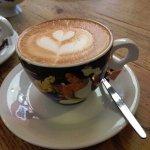 Latte art in an artsy cup