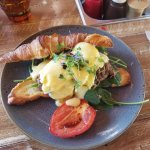 Eggs Benny special with slow cooked brisket, on a fresh croissant.