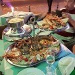 en dessous,langoustines,coquillages,calamars,legumes cuits