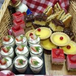 Selection of British desserts - eton mess, custard tart, trifle, bakewell tart, treacle tart