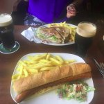 The footlong, the club sandwich and the loaded fries, with two pints of beer.
