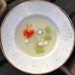 Chilled Tomato Consommé, Feta Basil, Basil Oil, Croutons & Wild Flowers