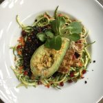 Zucchini noodle and red quinoa salad with grilled avocado, tofu and pesto