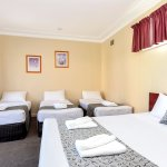 Family Room (1 Queen 3 Single Beds)
