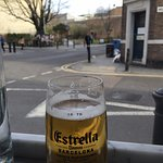 having an estrella, looking out at berms street