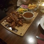Marinated Spare Ribs with dipping sauce and a side of chips