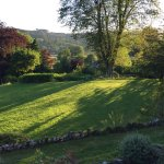 View across garden over Esthwaite Water in the evening.