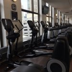 10 elliptical machines, 10+ treadmills, 2 steppers, 2 stair machines, curl bars to 110, db to 10