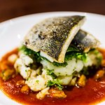 Pan Fried Seabass with shellfish and tomato sauce