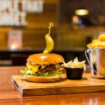 Gourmet Burger with cheddar cheese and pickle
