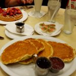 Stack of pancakes with maple syrup and compote