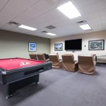 Billards, darts, juke box and big screen TV available just off the lounge.