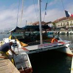 """This is the catamaran """"Le Coucher de Soleil"""", with the captain checking it out."""