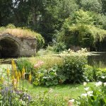 the garden borders onto the mill pond of the castle's mill and the River Avon
