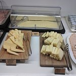 Cold cuts (including traditional Mortadella), high quality cheese at breakfast buffet)