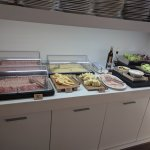 Cold cuts (including traditional Mortadella), high quality cheese, fresh salad at breakfast buff