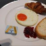 Bread, jam, fried egg, croissant (sample of items from breakfast buffet)