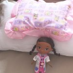 Doc McStuffins placed in baby cot by Housekeeping - personal touch thank you