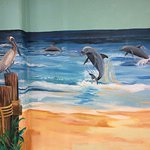 A mural in the poolside men's room.