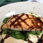 Pan seared Maine Salmon erved over whipped cauliflower with Horseradish, cheddar cheese, baby sp