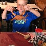 Grandson tries first crab