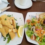 Calamari on rocket salad and fritata and salad - yummy