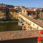 View of the Ponte Vecchio and the Arno river from the rooftop terrace.