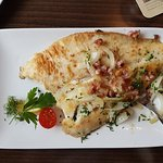 Sole with bacon and onions. It also came with a side order of sauteed potatoes and salad