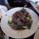 Beef Served On Top Of Greens