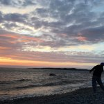 Skipping rocks during sunset