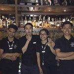 The cheerful bar tenders