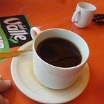 Coffee and Chiliaquiles con huevo estryados