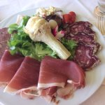 Salad with charcuterie selection