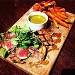 6oz Sirloin steak with sweet potato fries and chimichurri sauce available on our lunch menu