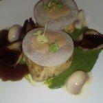 Rabbit, wild garlic puree, baby radish, kohlrabi ravioli filled with onion and sage juice