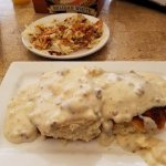 Biscuits and gravy with side of hash browns.