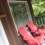 Lovely porch with Muskoka chairs to relax in at the end of a busy day