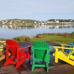 Rainbow chairs on the deck overlooking Twillingate Harbour
