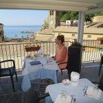 Rooftop balcony breakfast dining location with view of waterfront