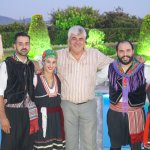 Owner Kostas onwith dancers on the 'Greek Night'