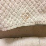 bath mat on rail, dirty stain